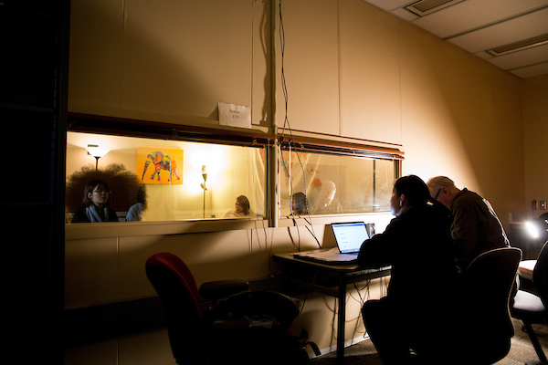researchers observing study through window